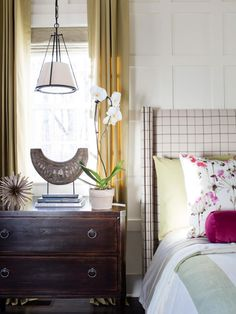 A star of HGTV Smart Home 2016, the master bedroom showcases a combination of chic modern design and pops of pink.