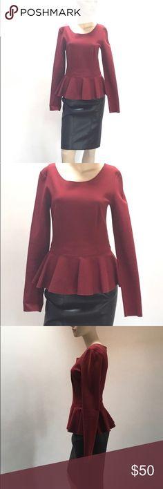 "Stella Mccartney peplum knit top. Heavyweight cotton blend knit peplum top in dark wine color. Flattering on all bodies.  Bust=35"", waist=27, length shoulder to hem=24"" Stella McCartney Tops"