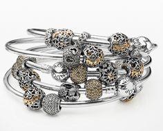 Mix two-tone charms on silver bangles to create this look #PANDORAlovesDisney #PANDORAbracelet