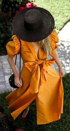 Black accessories with a brightly colored dress. Loving this look.
