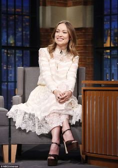 Sitting pretty: The screen star ditched her jacket for the occasion, looking perfectly put...
