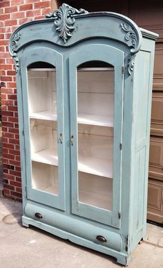Repurposed Gems: Light blue painted hutch redo with white shelves, glass doors. Not usually a fan of blue but this is nice.