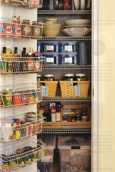 Extra deep wire shelving over door; stackable drawers for small items; large see-through boxes on floor store extra items.