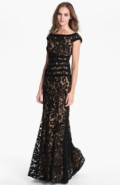 Burnout velvet lace overlay.  Lace print woven under.  Fit 'n flare fit.  Black bands around waist, neck, and armhole.  Back invisible zipper.  Imagine this in white and cream as a wedding dress.