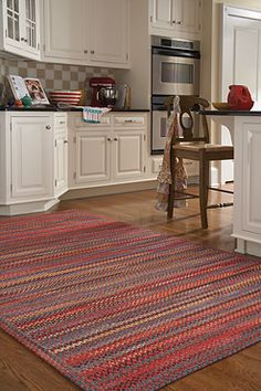 Capel Rugs / Songbird in cardinal / Inspired by vintage tableware and linens / Braided in the USA