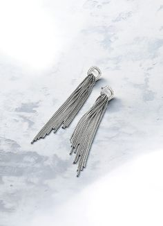 Chain earrings with diamonds sway with every movement.