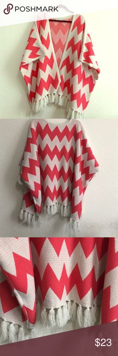 Poncho!! The cutest little poncho ever! Coral/pink colored chevron prints all through out. Tassels on the bottom. Sooooo cute!! charlee Sweaters Shrugs & Ponchos