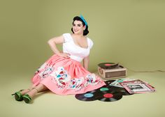 Good Morning Ladies and Happy Friday!!! Pink is my all time favorite color and some of you know my house is 1950's Pink!! So today we are doing Pretty in Pink!! Looking forward to a super glam day!!!  Pinup Model Yasmina Greco @crazy4me wearing @pinupgirlclothing Umbrella Print novelty skirt by Mary Blair and peasant top. Playing records and hanging out  https://instagram.com/p/-CIbtOpeTa/  . Photo by: Shameless Photography