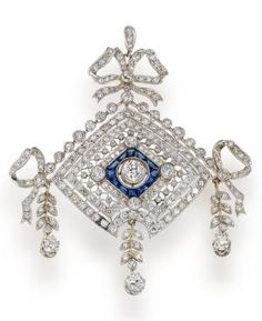 A diamond and sapphire pendant the openwork diamond shaped pendant centering an old European-cut diamond within a surround of sapphires, set throughout with old European-cut and single-cut diamonds; estimated total diamond weight: 5.05 carats; mounted in platinum; length 2 1/4in. Edwardian or Edwardian style. by LiveLoveLaughMyLife