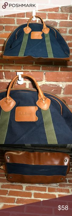 LL BEAN vintage carry on Vintage carry on bag from LL Bean. Cute and durable, this bag has three inside pockets. The bag is navy with forest green accenting. Bottom of the bag is leather brown, with four spikes to sit the bag down and not scuff the bag. Make me an offer! L.L. Bean Bags Travel Bags