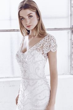 Anna Campbell bridal Ceremony Collection. Anna Embellished Trumpet dress in ivory. Hand beaded and perfect for the bride looking for a little vintage flare. Made in Australia.