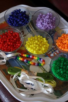 My Little Pony Birthday Party- Activity- Make bracelts/necklaces with assorted beads in a rainbow of colors. (The Landham Pad)
