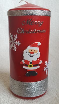 Christmas candle with Santa and Snowflakes from welshwaxesandcrafts.co.uk