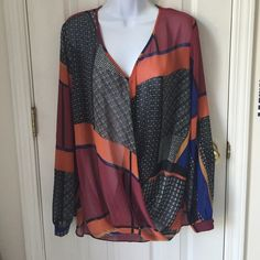 Long sleeve blouse Never worn. This purchase also comes with a free tube of lip gloss! Just comment 1-6 below. Tops Blouses