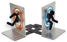 Portal Bookends Take these bookends, they'll hold the books up. Why yes, they do look exactly like a test subject going through a portal on one side and out the portal on the other. Pretty clever, isn't it? Sold on Think Geek. Portal 2, Idea Portal, Game Portal, Home Decor Accessories, Decorative Accessories, Deco Gamer, Aperture Science, Book Holders, Shelf Holders