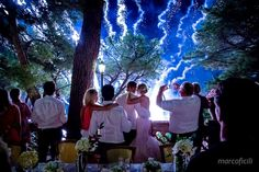 Bride and groom silhouette over the fireworks. Wedding at the Belmond Villa Sant'Andrea, Taormina.