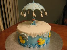 chocolate and french vanilla cake frosted with buttercream,fondant and gum paste ducks and umbrellas,foregot to do the writting on top of cake before putting the umbrella in so had remove and put back in.