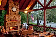 Time Flies  | Cabin Rentals of Georgia - Dine Along the Toccoa River on the Covered Porch featuring a Stone Fireplace