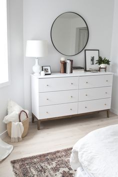 The perfect white dresser in this modern, scandi styled bedroom redesign