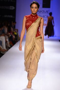 Gold with red embroidery dhoti sari gown available only at Pernia's Pop-Up Shop.