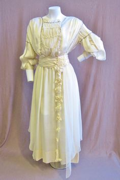 The sleeves on this dress are really cool.  1910's Ivory Silk Wedding Dress Small 26 by ViasVintage on Etsy, $225.00