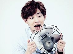 Manager: Do you wanna take a picture with a fan? Chanyeol: Sure!  Manager: Not litera- Chanyeol: *brings up fan* Manager: Whatever.