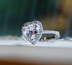 1.96ct Heart white sapphire 14k white gold by EidelPrecious, $2100.00 this is exactly what i want :o i would make the switch if my man wasn't so traditional!!