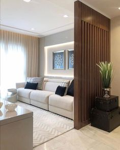 How beautiful this room with slatted wood partition! I loved and you? Living Room Partition Design, Living Room Divider, Living Room Tv Unit Designs, Room Partition Designs, Home Living Room, Wood Partition, Home Room Design, Home Interior Design, Home Decor Sets
