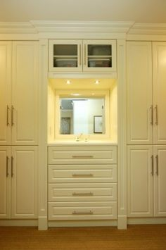 a little lower with open bottom and could be vanity in the closet--might work