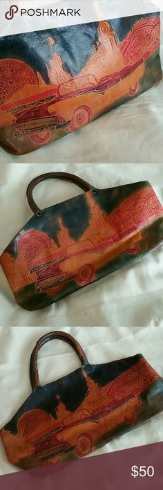 "Ultra Sheik Art Deco Handbag Vintage Leather Purse Snap Closure at top. Convertible car with a carnival in the background: ferris wheel and roller coaster are visible. 8 inch tall to the top of the bag by  14 inches wide. Old tag says ""Made in India"". Signature inside (see photo). The perfect bag for the old car collector. Vintage Bags"