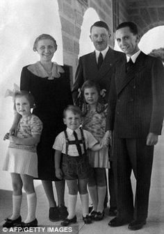 Adolf Hitler with his propaganda minister Jospeh Goebbels, his wife Magda, and three of their children in 1938. Goebbels & Magda would commit suicide (after killing their 6 children) after Hitler & new wife Eva Braun committed suicide, in Underground Bunker by bernadine