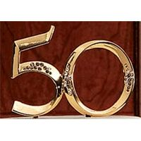 The 50th Anniversary Monogram Cake Topper displays the number of years married! Appointed in rhinestones, a sparkling pick makes a beautiful keepsake for the honored couple. Use as a cake topper and in floral arrangements, bouquets and centerpieces.
