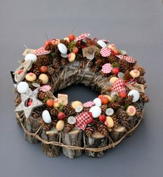 advent wreath with natural materials (pine cones, apples...)