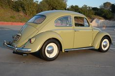 This 1964 Volkswagen Beetle features a mild resto-mod build which took the seller 1.5 years to complete. It was taken down to bare metal and painted VW Mango Green. It received a new interior, new suspension, and brakes, along with a rebuilt 40 HP 1200cc engine.