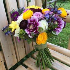 Colorful Bouquet of dahlias, ranunculus, roses and delphinium for a Farm-Style Wedding - Floral Artistry
