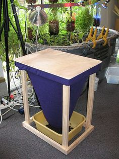 worm composting system - self sorting, worms on top, compost on the bottom. Plus it's a table...