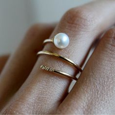 Visibly Interesting: 14K Gold Pearl and Diamond wrap ring features a 5.5mm Freshwater Pearl on one end and three 1mm White Diamonds accenting the other