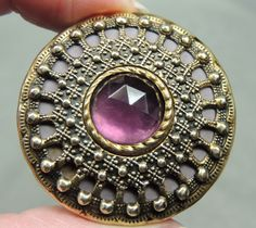 BRASS BUTTON W/ FACETED AMETHYST GLASS JEWEL GAY 90 s METAL