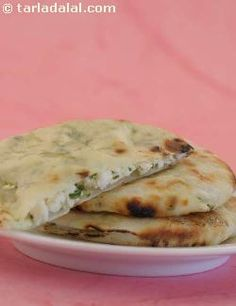Masala paneer naan: a flavourful stuffed naan with a filling of paneer, green chillies and coriander, masala paneer naan is indeed a dish that will set you apart as a gourmet chef! it cooks really well on a tava without the need for a tandoor.