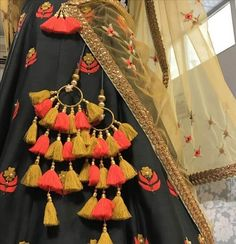 The ultimate list of gorgeous Lehenga and Blouse Latkan designs that are ruling the internet. From tassels to pom-pom designs, choose not just one but more. Saree Tassels Designs, Lehenga Designs, Indian Attire, Indian Wear, Indian Dresses, Indian Outfits, Pakistani Dresses, Indian Designer Wear, Textiles