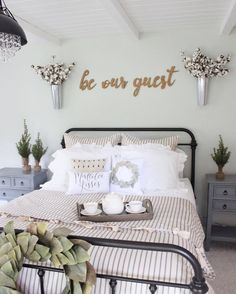 Farmhouse guest bedroom with rod iron bed from bedding from black crystal chandelier from and be our guest wood signs. Farmhouse Style Bedrooms, Farmhouse Master Bedroom, Farmhouse Style Decorating, Home Bedroom, Bedroom Ideas, Dream Bedroom, Bedroom Designs, Modern Bedroom, Country Bedrooms
