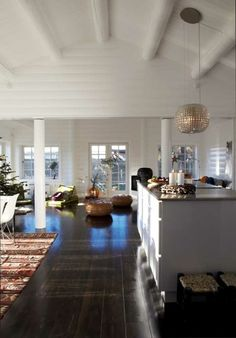 Love the rich, dark wood floors with white walls, ceiling.