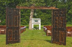 rustic doors and mantel set the stage for a vintage outdoor wedding