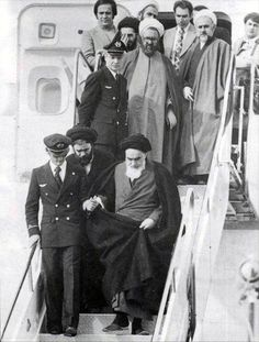 """Imam khomeini (ra) on his arrival from France"" you know I've always wondering who is that guy on the left that holds Imam's hand?! :v"