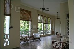 Outdoor Living Space - Tropical British colonial architecture and design