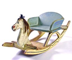 """19th C. Paint-Decorated rocking Horse    Early painted rocking horse in excellent original surface. The decoration is freehand and the colors remain vivid.Square-nailed construction with a horsehair mane. Where most 19th C. rocking horses have a vertical aspect, at only 12""""w x 14""""h this less common form is lower to the ground. Found in New England. Circa 1860-1875."""