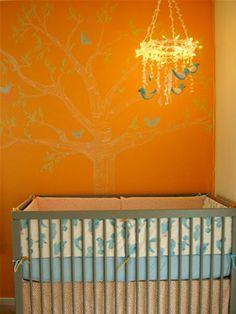 Nature-Themed Nurseries -orange walls, tree, chandelier, birds