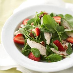 A warm fruit dressing tops this main-dish chicken and berry salad.