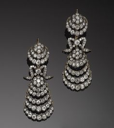 PAIR OF GOLD, SILVER AND DIAMOND PENDANT EARRINGS. Victorian or Victorian style.