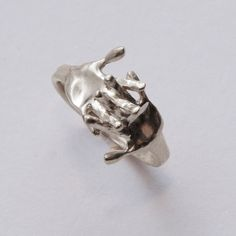 Cool intertwined hands ring.